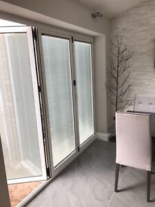 Quality Aluminium Bi fold Doors inc Integrated blinds 3 panels. 2.4m x 2.1