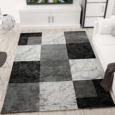 Alfombra moderna para el salón jaspeada cuadrados grises negros y blancos