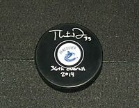 THATCHER DEMKO AUTOGRAPHED SIGNED VANCOUVER CANUCKS PUCK NHL