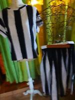 femme jupe a plis noir et blanc +haut en plus T 38-40