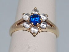 10k Gold ring with Sapphire(Sept birthstone) and CZ diamonds in a flower design