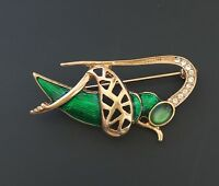 Vintage  style grasshopper brooch in enamel on gold tone metal.with crystals