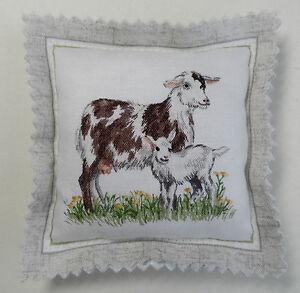 Handmade pin cushion. A Goat and her kid. 9cm x 9cm.