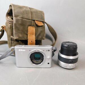 Nikon 1 J1 10.1MP Digital Camera - Silver VR 10-30mm f/3.5-5.6 Lens & Case BK/JP