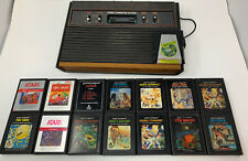 Atari 2600 Launch Edition Woodgrain Console with 15 Games! -not tested