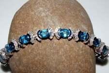18.18 Ct Oval Swiss Blue Topaz Sim Diamond Women's Tennis Bracelet in 925 Silver