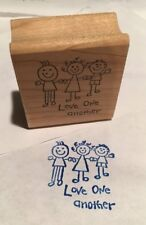 "two rubber stamps mounted on wood ""Love one another"" ""Have a sunny day"""