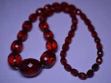 VINTAGE 23 INCH LONG GRADUATED FACETED AMBER BAKELITE NECKLACE