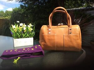 Ted Baker tan leather top handles bag with gold T logo and dust cover