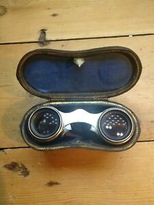Vintage opera glasses in leather case