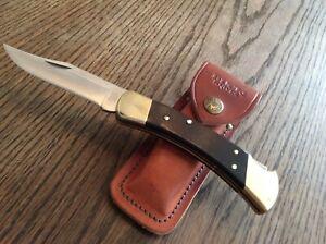 Buck Folding Hunter 110 Taschenmesser mit Holzgriff