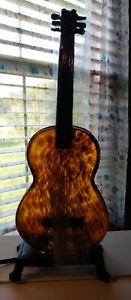 """15"""" Tall Amber Glass Guitar Shaped Lamp With Metal Base"""