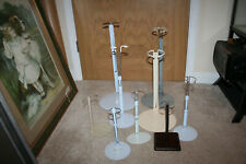 Lot of nine various sized adjustable doll display stands