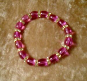 8 inch Hot Pink Glass Beads with Gold and Rhinestones  Accents Lady's Bracelet