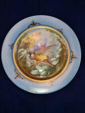 Assiette porcelaine à décor d'oiseau peinte à la main, marli bleu, époque N III