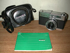VINTAGE KONICA EE-MATIC DELUXE F 35MM CAMERA WITH CASE AND OWNER'S MANUAL