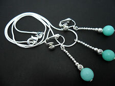 A SILVER PLATED BLUE JADE  NECKLACE AND CLIP ON EARRING SET. NEW.