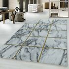 NAXOS GEOMETRIC SQUARED MARBLE-LIKE SOFT RUG IN GOLD SILVER ON WHITE CARPET
