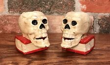 Pair of Cast Iron Vintage Skeleton Skull on Red Book Candle Holders