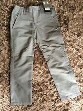 Boys Under Armour golf trousers light grey size small