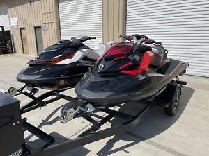 two seadoo jet skis with trailer sea-doo