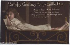 Girl Child laying on a bed vintage Postcard from 1907