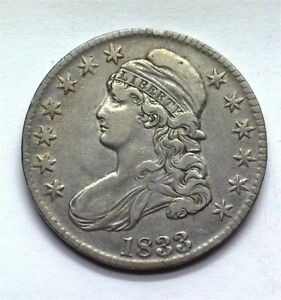 1833 CAPPED BUST SILVER 50 CENTS NEARLY UNCIRCULATED
