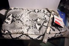 Fau snakeskin wristlet by Fashion Bug inside zuppered pocket, zippered top..