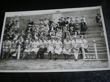 Old real photograph postcard people sitting on steps c1920s