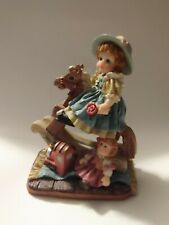 Figurine by K's Collection Little girl ridding a rocking horse.