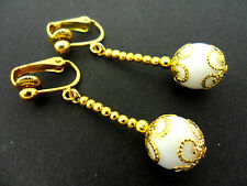 A PAIR OF DANGLY WHITE JADE  BEAD GOLD PLATED DROP CLIP ON EARRINGS.
