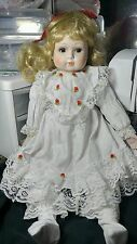 Porcelain doll 22 inch with blonde curls, brown eyes,