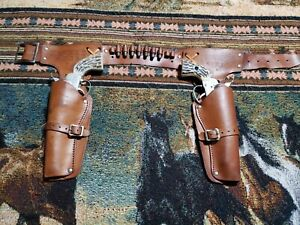 REFURBISHED MATTEL FANNER 50 HOLSTERS W/7 BULLETS. NO GUNS INCLUDED IN THIS SALE