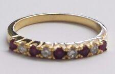 18 KARAT YELLOW GOLD DIAMOND AND RUBY BAND , SIZE 6