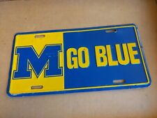 Vintage Michigan Wolverines Embossed Go Blue Metal License Plate Auto Tag Sign