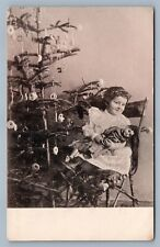 GIRL w/ DOLL under CHRISTMAS TREE w/ ORNAMENTS ANTIQUE GERMAN POSTCARD NEW YEAR