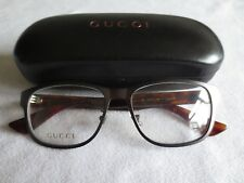 Gucci brown / bronze / red glasses frames. GG0007O. With case.