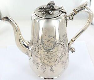 .1850 ENGLISH STERLING SILVER HEAVY SET DECORATIVE COFFEE POT. MAKER JOHN TAPLEY