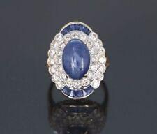 Anelli di lusso con gemme blu cabochon in oro giallo