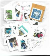 Lot # 424    Canada 50   STAMPS ON PAPER