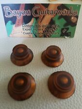 Gibson Les Paul Hand Aged Amber bell knobs.