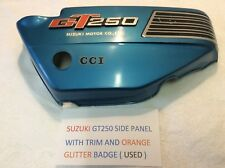 SUZUKI GT250 SIDE PANEL WITH TRIM AND ORANGE GLITTER EMBLEM AND DECALS USED GOOD