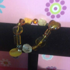 AMBER COLOURED STRETCH BRACLET BNWT FREE POSTAGE (L)