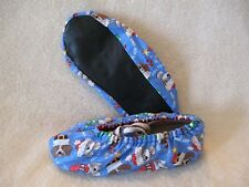 Christmas doggies on sparkle material. Ladies  shoe covers size. 6-7.