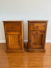 Two (matching pair) wooden bedside tables. Condition is used