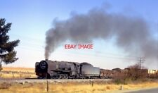 PHOTO  SOUTH AFRICAN RAILWAYS - DARKENING AN OTHERWISE CLOUDLESS CLEAR BLUE SKY