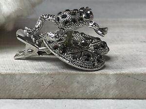 antiqued-silver tone frog tie pin on lilly pad with rhinestones