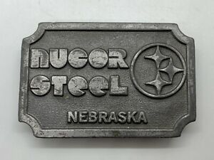 Vintage NUCOR STEEL Nebraska Belt Buckle featuring NFL Steelers Steelmark Logo