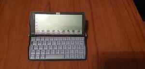 Vintage Psion Revo Plus 16MB Palmtop Computer with docking station & Hard Case.