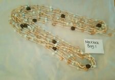 Multistrand glass bead necklaces fabric multicoloured neutral colour